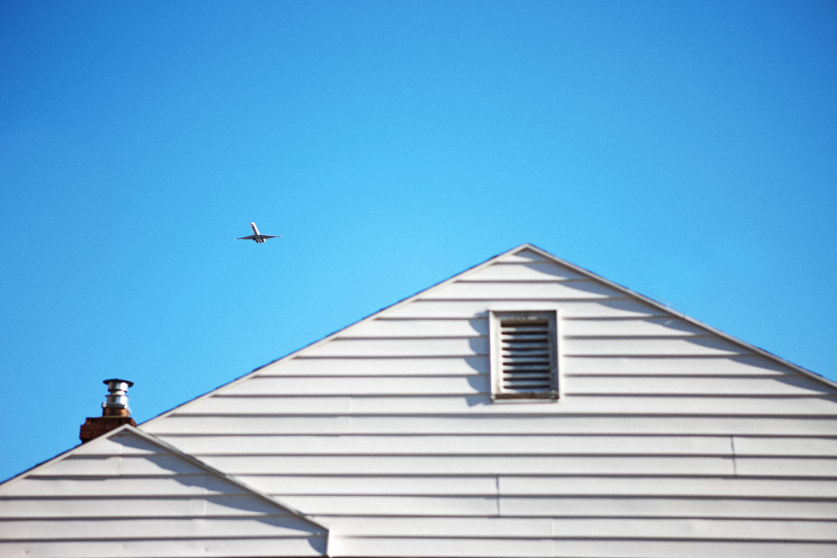 Airplane flight path over suburban homes by quirky advertising photographer Anthony Georgis | www.anthonygeorgis.com