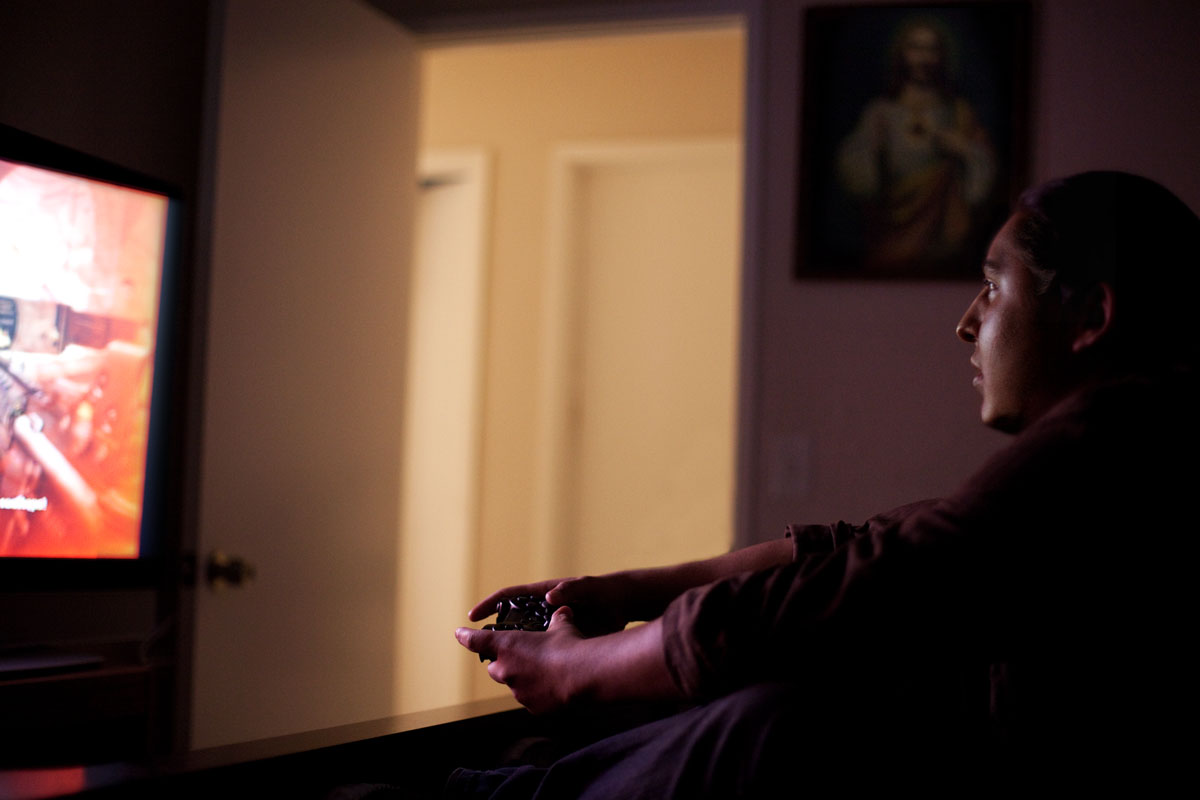 Portrait of a man playing video games by real life reportage photographer Anthony Georgis | www.anthonygeorgis.com