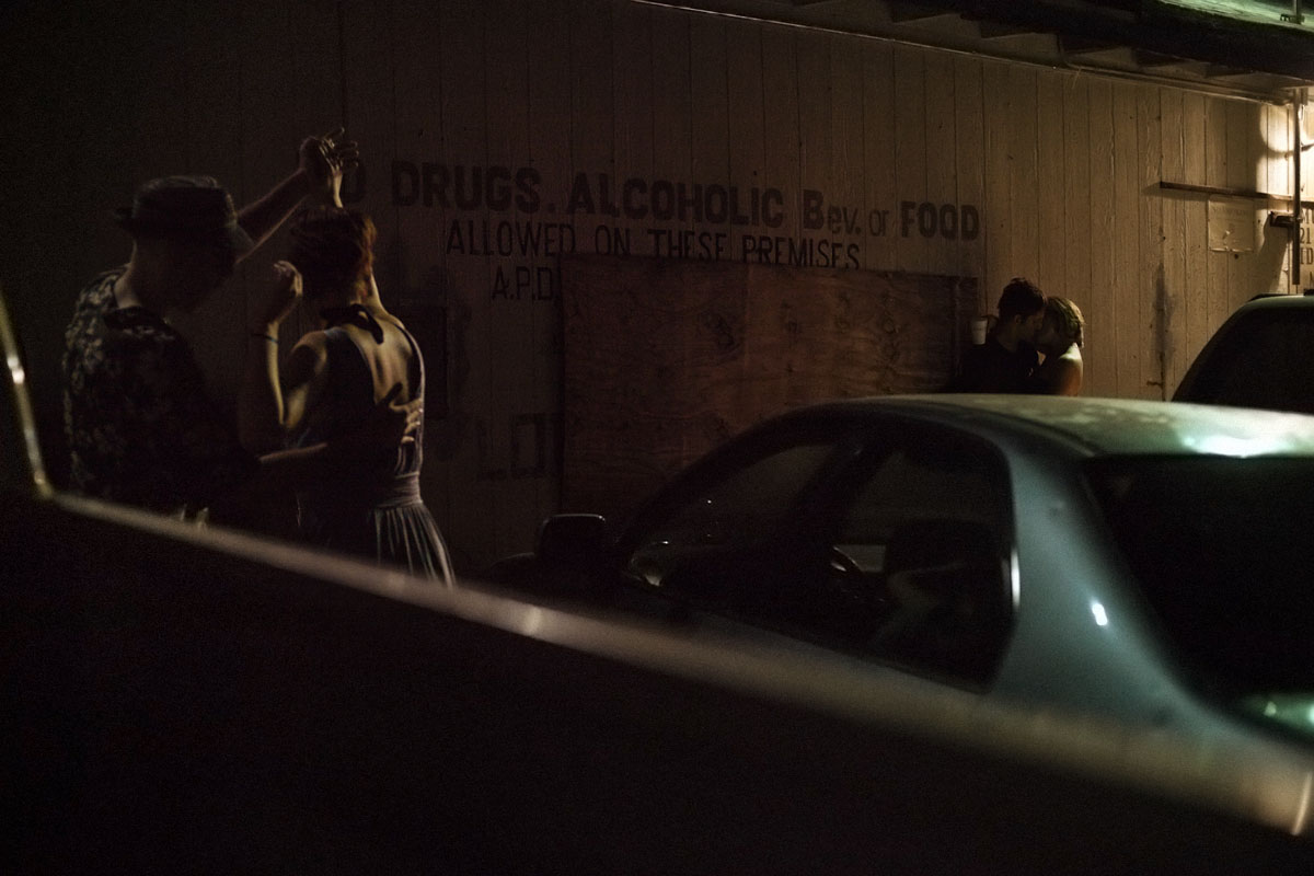 Couples dance and make out in a parking lot in Austin by photographer Anthony Georgis | www.anthonygeorgis.com